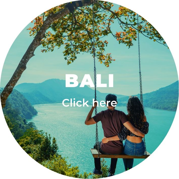A couple on a swing overloking a lake in Bali